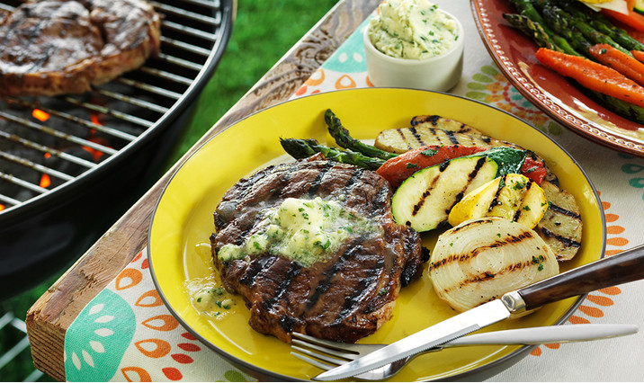 Grilled Ribeyes with Horseradish Garlic Butter Sauce